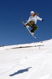 Female snowboarder jump shadow Royalty Free Stock Photos
