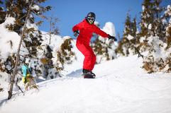 Female snowboarder on mountain slope Stock Image
