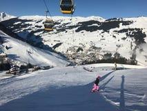 Female snowboarder on piste Royalty Free Stock Photo