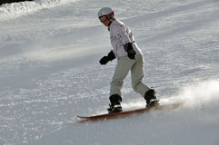 Female snowboarder in powder snow Royalty Free Stock Images