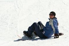 Female snowboarder on slope Stock Image