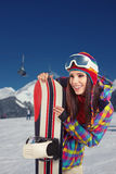 Female snowboarder on top of the mountain Stock Photography