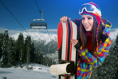 Female snowboarder on top of the mountain Stock Photo