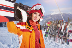Female snowboarder on top of the mountain Royalty Free Stock Photography