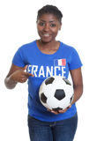 Female soccer fan from France with ball Royalty Free Stock Image