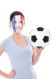 Female soccer fan from France holding a football Royalty Free Stock Images