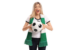 Female soccer fan with a scarf and football cheering Stock Image