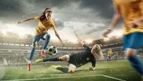 Free Female Soccer Or Football Players Kicking Ball At The Stadium Stock Photo - 159354430