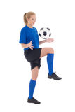 Female soccer player in blue uniform playing with ball isolated Royalty Free Stock Images