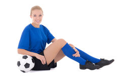 Female soccer player in blue uniform sitting with ball isolated Royalty Free Stock Images