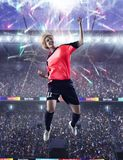 Female soccer player celebrating goal royalty free stock images