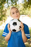 Female soccer player on the field. Portrait of female soccer player on the field royalty free stock photos