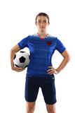 Female Soccer Player Holding Ball Stock Photography