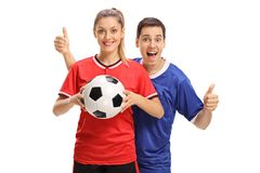 Female soccer player holding football and male soccer player hol Royalty Free Stock Images