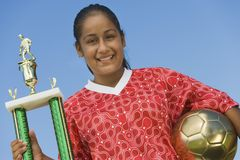 Female Soccer Player Holding Trophy Stock Image