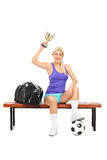 Female soccer player holding a trophy Royalty Free Stock Photos
