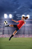 Female Soccer Player Kicking Ball Stock Photos
