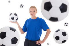 Female soccer player over white background with flying leather b. Female soccer player in blue uniform over white background with flying leather balls stock images