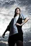 Female Soccer player posed. A young female soccer player poses against a dramatic background Royalty Free Stock Images