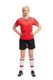 Female soccer player in a red jersey Royalty Free Stock Photography