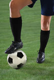 Female Soccer Player Stepping on Ball Royalty Free Stock Images