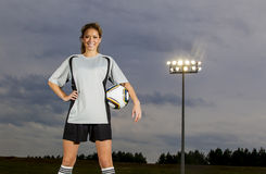 Female Soccer Player. Working out on a soccer field Stock Images