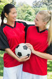 Female soccer players looking at each other Royalty Free Stock Photo