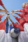 Female Soccer Team High-Fiving Stock Photography