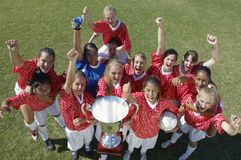 Female Soccer Team Holding Trophy Stock Images