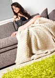 Female sofa blanket Stock Image