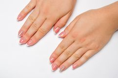 Female soft hands with beautiful french manicure. isolated white background. long nails. place for text. copy space stock photo