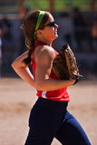 Female softball player jogs off field Royalty Free Stock Photos