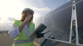 Female solar constructor is working with gadgets