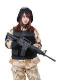 Female soldier in battle uniform. Stock Photos