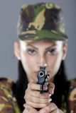 Female soldier in camouflage uniform with weapon Royalty Free Stock Images