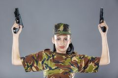 Female soldier in camouflage uniform with weapon Stock Images