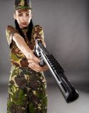 Female soldier in camouflage uniform with weapon Royalty Free Stock Image