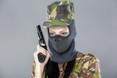 Female soldier in camouflage uniform with weapon Royalty Free Stock Photo