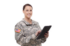 Female soldier with digital tablet Royalty Free Stock Images