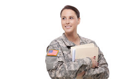 Female soldier with folder looking away Stock Photos