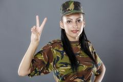 Female soldier gesturing peace sign Royalty Free Stock Photos