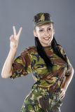 Female soldier gesturing peace sign Stock Photography