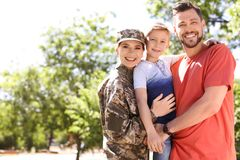 Female soldier with her family, outdoors. Military service. Female soldier with her family outdoors. Military service royalty free stock image