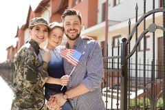 Female soldier with her family, outdoors. Military service. Female soldier with her family outdoors. Military service stock photo