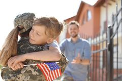 Female soldier with her son outdoors. Military service. Female soldier hugging with her son outdoors. Military service royalty free stock photography