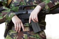 Female soldier holding a gun Royalty Free Stock Image