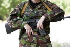 Female soldier holding a gun Stock Image