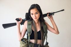 Female soldier with M16 rifle gun stock images