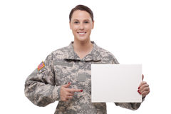 Female soldier pointing at a blank placard Stock Images