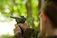 Female soldier shooting with a pistol Royalty Free Stock Image